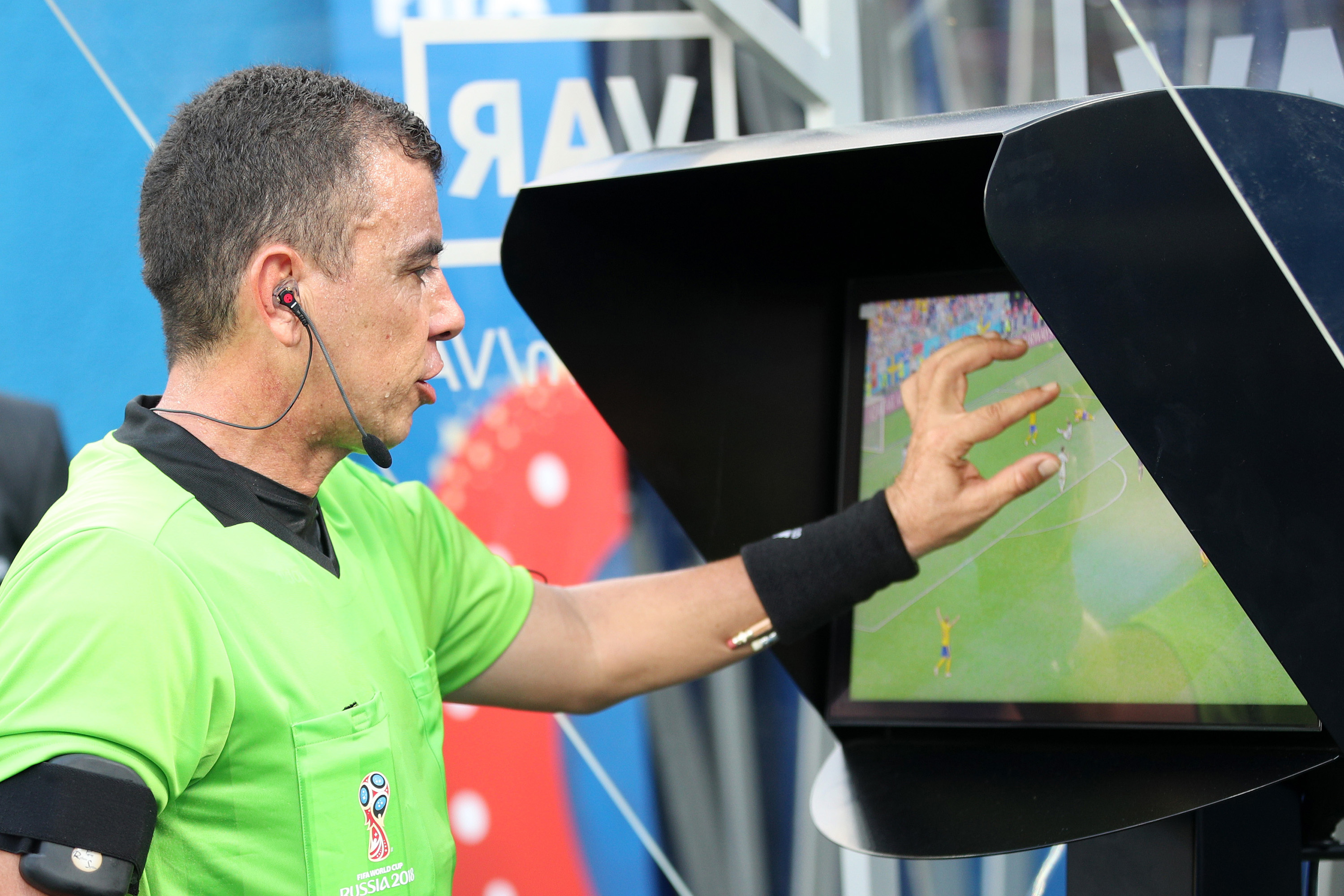 NIZHNIY NOVGOROD, RUSSIA - JUNE 18: Referee Joel Aguilar reviews the VAR footage, before awarding Sweden a penalty during the 2018 FIFA World Cup Russia group F match between Sweden and Korea Republic at Nizhniy Novgorod Stadium on June 18, 2018 in Nizhniy Novgorod, Russia. (Photo by Adam Pretty - FIFA/FIFA via Getty Images)