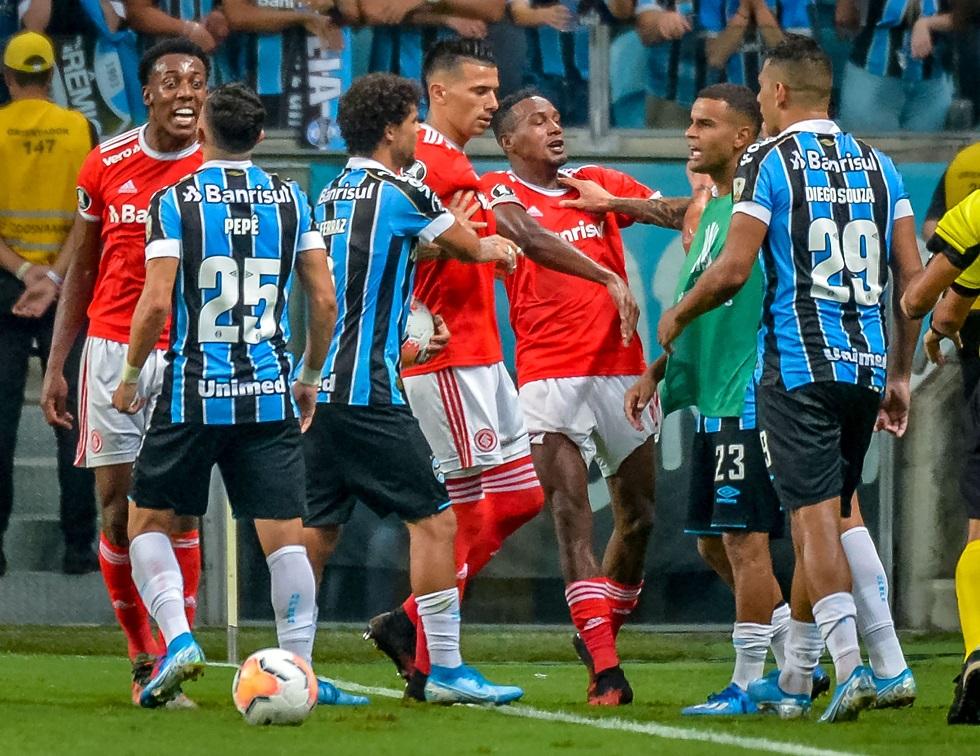 Brazil's Internacional and Brazil's Gremio players take part in a brawl during their 2020 Copa Libertadores match at the Arena do Grêmio, in Porto Alegre, Brazil, on March 12, 2020. / AFP / SILVIO AVILA