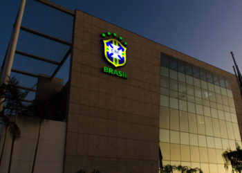 The Brazilian Football Confederation's logo shines at night on the facade of the CBF headquarters in Rio de Janeiro, Brazil, on June 8, 2015. AFP PHOTO / YASUYOSHI CHIBA (Photo credit should read YASUYOSHI CHIBA/AFP/Getty Images)