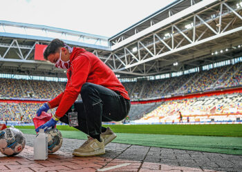 Footballs are disinfected during the Bundesliga soccer match between Duesseldorf and Paderborn in the Merkur Spiel-Arena, Duesseldorf, Germany, Saturday, May 16, 2020. The German Bundesliga becomes the world's first major soccer league to resume after a two-month suspension because of the coronavirus pandemic. (Sascha Schuermann/AFP pool via AP)
