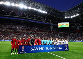KAZAN, RUSSIA - JUNE 28: The teams lineup with an anti racism banner before the FIFA Confederations Cup Russia 2017 Semi-Final between Portugal and Chile at Kazan Arena on June 28, 2017 in Kazan, Russia. (Photo by Chris Brunskill Ltd/Getty Images)