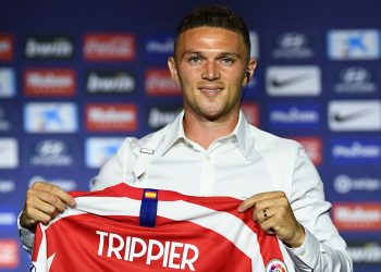 Atletico Madrid's new English defender Kieran Trippier holds his new jersey during his official presentation by the Spanish football club at the Wanda Metropolitano stadium in Madrid on July 18, 2019. (Photo by GABRIEL BOUYS / AFP) (Photo credit should read GABRIEL BOUYS/AFP/Getty Images)