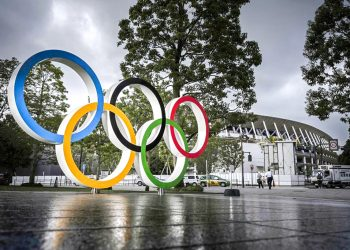 Photo shows a monument depicting the Olympic rings in front of the National Stadium in Tokyo, the main venue for the Tokyo Olympics and Paralympics, on July 22, 2020. The 2020 Tokyo Games have been postponed for a year due to the coronavirus pandemic. (Photo by Kyodo News via Getty Images)