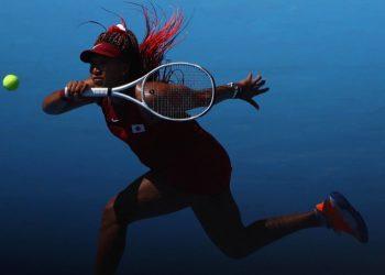 Tokyo 2020 Olympics - Tennis - Women's Singles - Round 1 - Ariake Tennis Park - Tokyo, Japan - July 25, 2021. Naomi Osaka of Japan in action during her first round match against Zheng Saisai of China REUTERS/Edgar Su